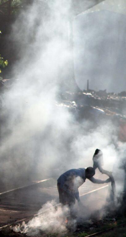 . Smoky garbage fire along the tracks in Delhi. Shmuel Thaler/Sentinel