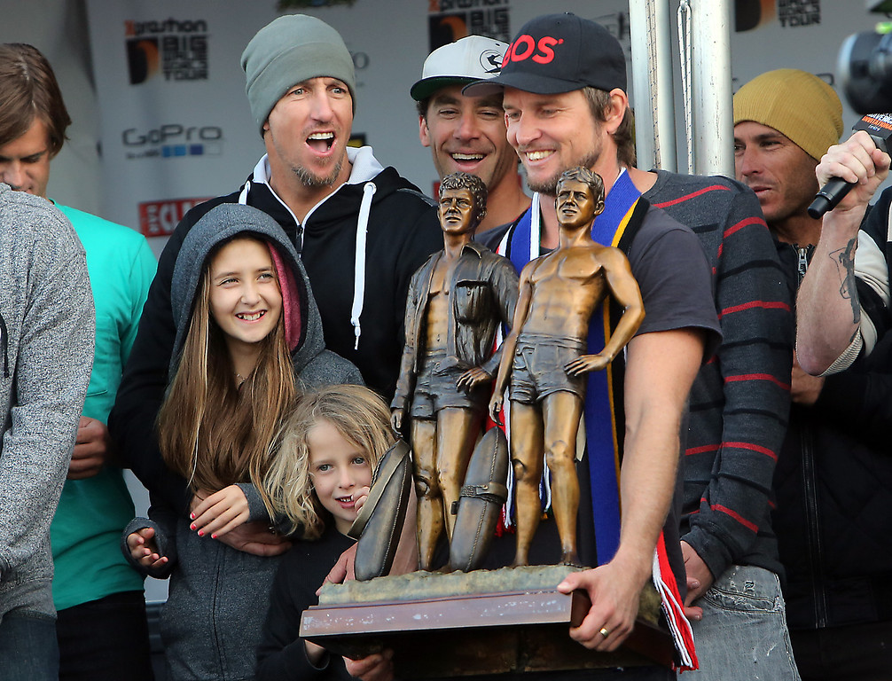 . Grant Baker is presented with the Mavericks Invitational first place trophy in Half Moon Bay on Friday afternoon after beating out legions of big wave surfers from Santa Cruz and beyond. (Kevin Johnson/Sentinel)