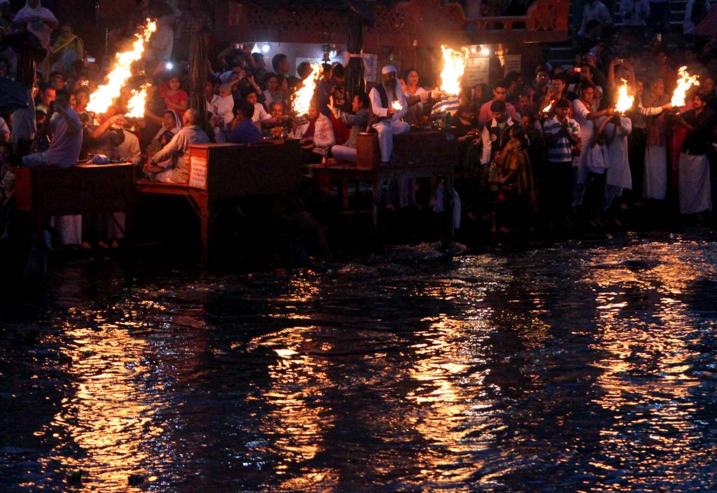 . The nights is ablaze with flames from ceremonial ail lamps at Aarti along the Ganges in Haridwar, India on Friday. Photos by Shmuel Thaler/Santa Cruz Sentinel