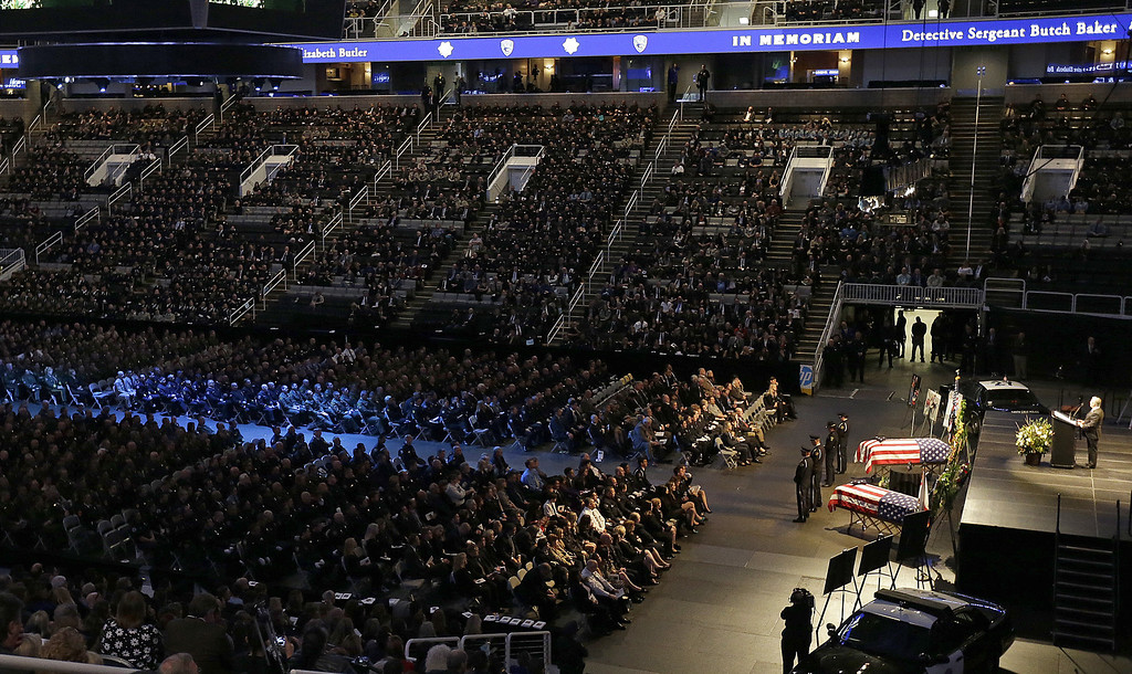 . Police officers from across the state attend a memorial service for slain Santa Cruz police Sgt. Loran Baker and detective Elizabeth Butler Thursday, March 7, 2013, at HP Pavilion  in San Jose, Calif. Baker and Butler were shot to death on Feb. 27, after arriving at the home of Jeremy Peter Goulet to question him about a misdemeanor sexual assault. (AP Photo/Ben Margot)