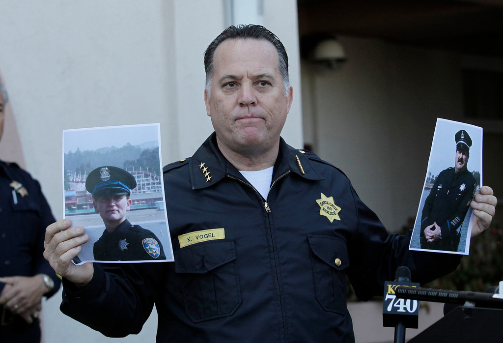 ". Santa Cruz Police Chief, Kevin Vogel holds photo of slain Santa Cruz police officers, detective Elizabeth Butler and detective Sgt. Loran ""Butch\"" Baker, during a press conference in front of the police department in Santa Cruz, Calif. on Wednesday, Feb. 27, 2013. The pair were gunned down yesterday while investigating a possible domestic violence or sexual assault when a suspect fired at them. The gunman, Jeremy Peter Goulet, was later gunned down when he exchanged gunfire with police during a manhunt. (Gary Reyes/ Staff)"