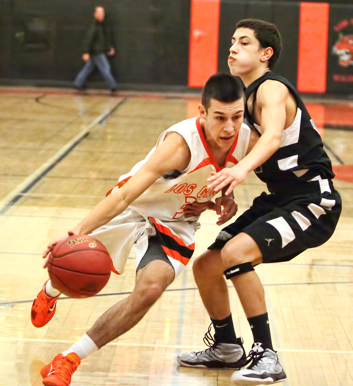 . Los Gatos High\'s Tyler Gomes (3) looks to score in the first round of the Central Coast Section Division II playoffs vs. Pajaro Valley in Los Gatos, Calif., on Feb. 19, 2013. Los Gatos won 61-35. (Cathy Cowden/for SVCN)