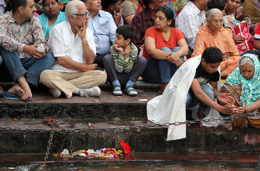 . Indians place an offering into the Ganges during Aarti on Friday. Photos by Shmuel Thaler/Santa Cruz Sentinel