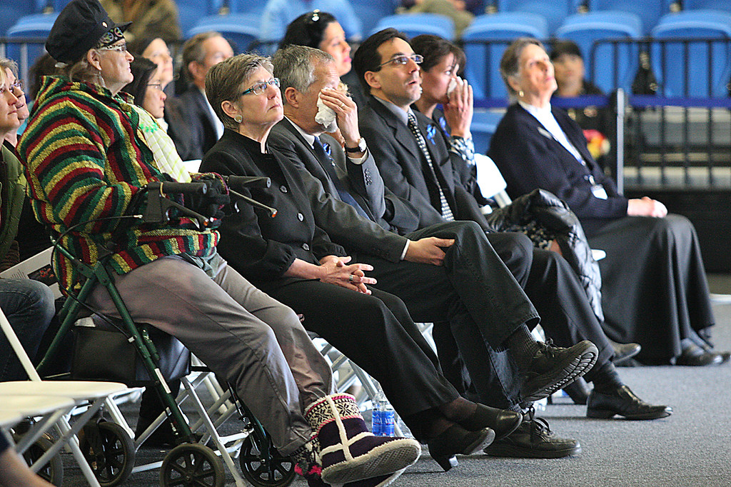 . Mourners in Santa Cruz\'s Kaiser Permanente Arena--some wiping tears from their eyes--watch the live telecast of the San Jose memorial for slain Santa Cruz Police detectives Sgt. Loran \'Butch\' Baker and Elizabeth Butler Thursday.  (Dan Coyro/Sentinel)