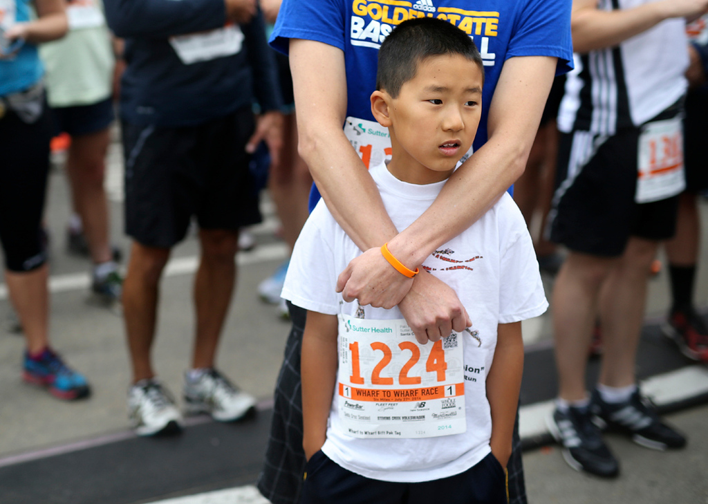 . Families joined elite runners from across the world to run in the 42nd annual Wharf to Wharf race in Santa Cruz on Sunday. (Kevin Johnson -- Santa Cruz Sentinel)