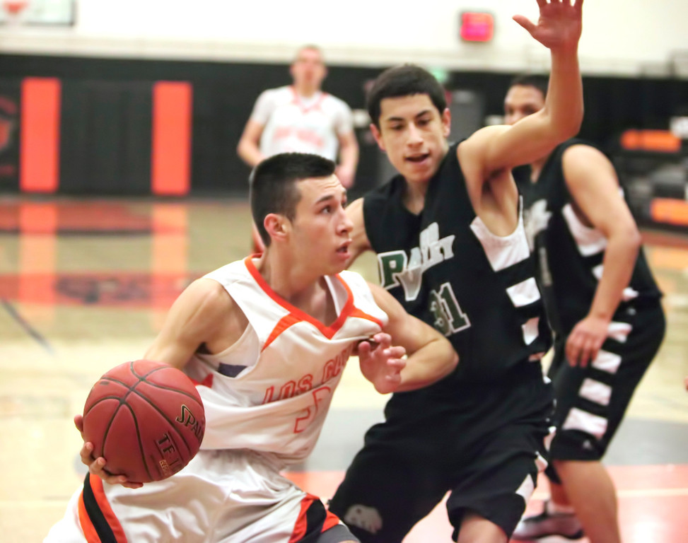 . Los Gatos High\'s Tyler Gomes (3) looks to score in the first round of the Central Coast Section Division II playoffs vs. Pajaro Valley at Los Gatos High on Feb. 19, 2013. Los Gatos won 61-35. (Cathy Cowden/for SVCN)