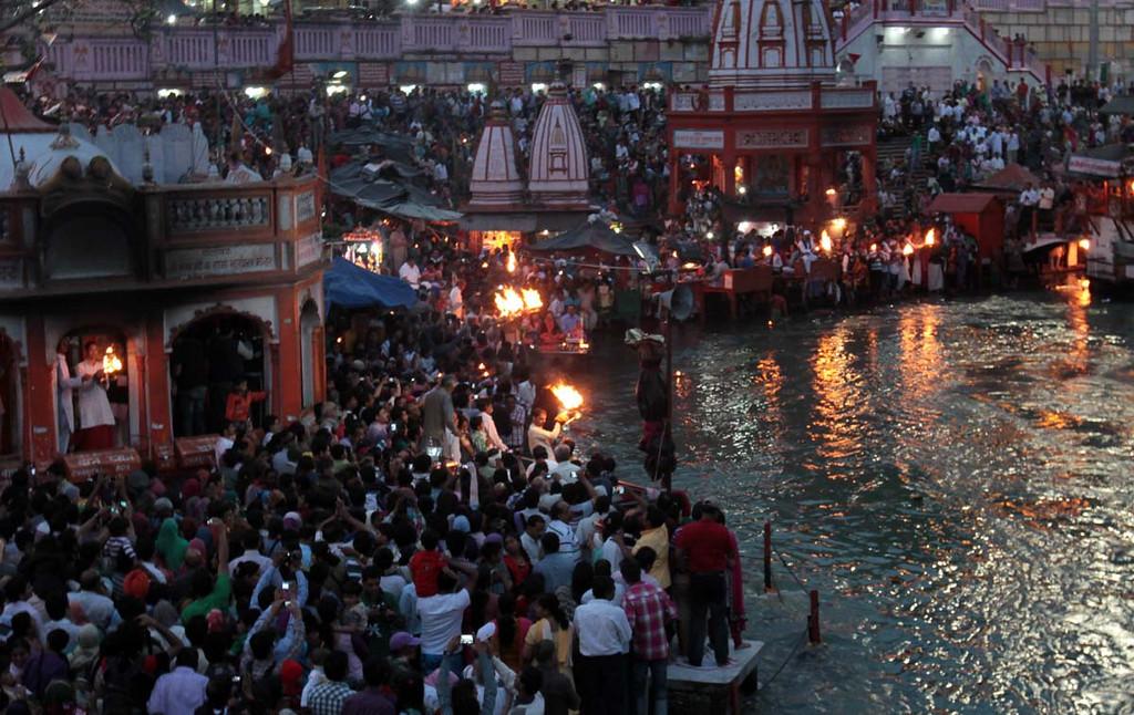 . Oil lamps begin to flare at the Aarti ceremony at Hari Kapari in Haridwar, India on Friday. Photos by Shmuel Thaler/Santa Cruz Sentinel