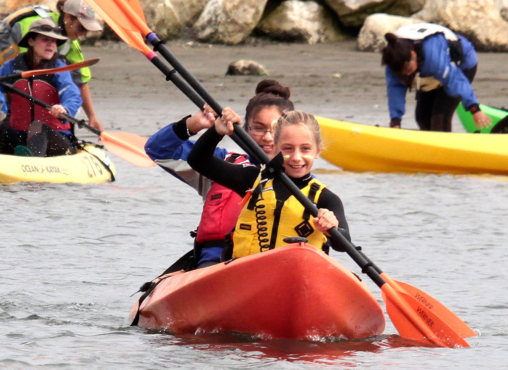 . Thirty-one middle school students from Santa Cruz, Monterey and San Benito Counties participating in Monterey Bay Aquarium�s Young Women in Science camp paddle into Elkhorn Slough from Moss Landing on Wednesday morning. The young scientists observed sea otters, harbor seals as well as a plethora of bird species during their outing, where they were accompanied by 7 high school �helpers� and a number of adult chaperones and guides from Monterey Bay Kayaks. This week-long, summer day-camp is designed to get young women excited about and involved in science, the ocean and conservation through a variety of hands-on field activities. Kids get the opportunity to explore ocean habitats by joining in activities such as surface scuba diving, boogie boarding and kayaking. The program serves young women regardless of primary language or economic background through three camps in the summer that are conducted in both English and Spanish. Young women entering grades 6, 7 or 8, who reside in Monterey, Santa Cruz and San Benito counties, are eligible to apply. (Shmuel Thaler/Sentinel)
