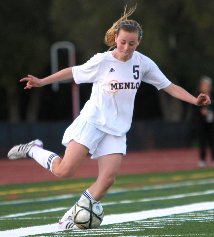 . Menlo\'s Maya Norman kicks the ball down field during a CCS Div. III semifinal game against Harbor in the second half at Menlo-Atherton High School in Atherton on Wednesday, Feb. 27, 2013. (Kirstina Sangsahachart/ Daily News)
