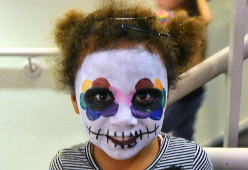 . Dozens of visitors up to get their faces painted in traditional Day of the Dead fashion. (Photo by Kala Narayan/MAH Photo Intern)