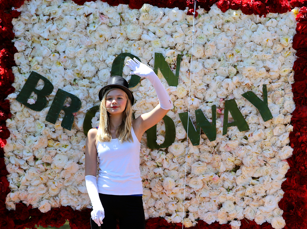 . A young parade participant waves to the crowds during the annual Begonia Festival on Sunday. (Kevin Johnson -- Santa Cruz Sentinel)