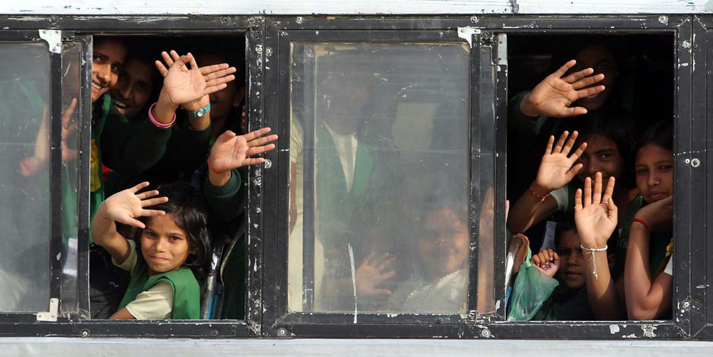 . Pardada Pardadi School students heading home  by one of the school\'s buses wave a final goodbye to the seniors from Mount Madonna School on March 26 as the students from the Watsonville school head on to their visit to the Taj Mahal in Agra.
