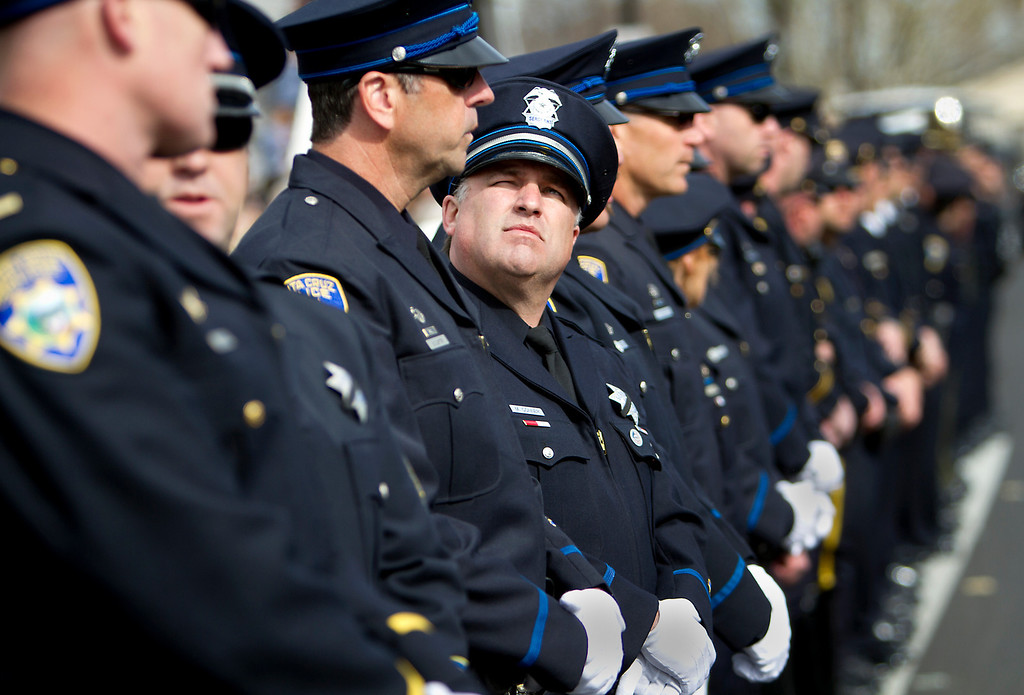 . Santa Cruz Police officers line up outside of the HP Pavilion in San Jose on Thursday to pay their respects during the memorial service for detective Sgt. Loran \'Butch\' Baker and detective Elizabeth Butler. (Kevin Johnson/Sentinel)