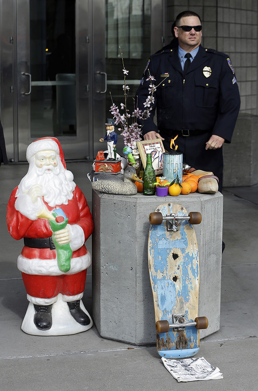 . A makeshift memorial is seen outside HP Pavilion where a memorial service is to be held in honor of slain Santa Cruz police Sgt. Loran Baker and detective Elizabeth Butler Thursday, March 7, 2013, in San Jose, Calif. Baker and Butler were shot to death on Feb. 27, after arriving at the home of Jeremy Peter Goulet to question him about a misdemeanor sexual assault. (AP Photo/Ben Margot)