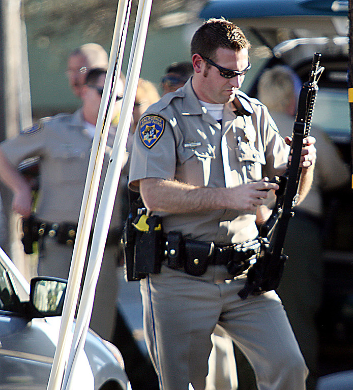 ". A CHP office loads an ammunition clip into his rifle near the shooting scene Tuesday where <a href=""http://www.santacruzsentinel.com/localnews/ci_22674808/breaking-2-officers-1-suspect-shot-santa-cruz\"">two Santa Cruz Police detectives were shot and eventually died along with one suspect.</a> (Dan Coyro/Sentinel)"