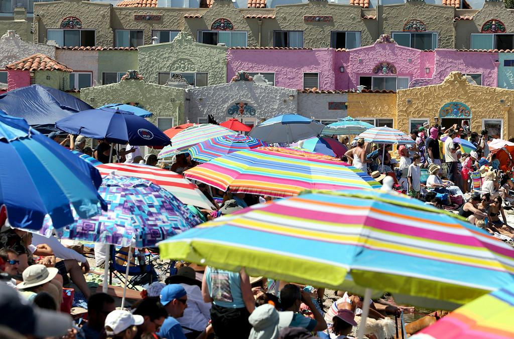 . Thousands fill Capitola Beach along Soquel Creek on Sunday during the annual Begonia Festival. (Kevin Johnson -- Santa Cruz Sentinel)