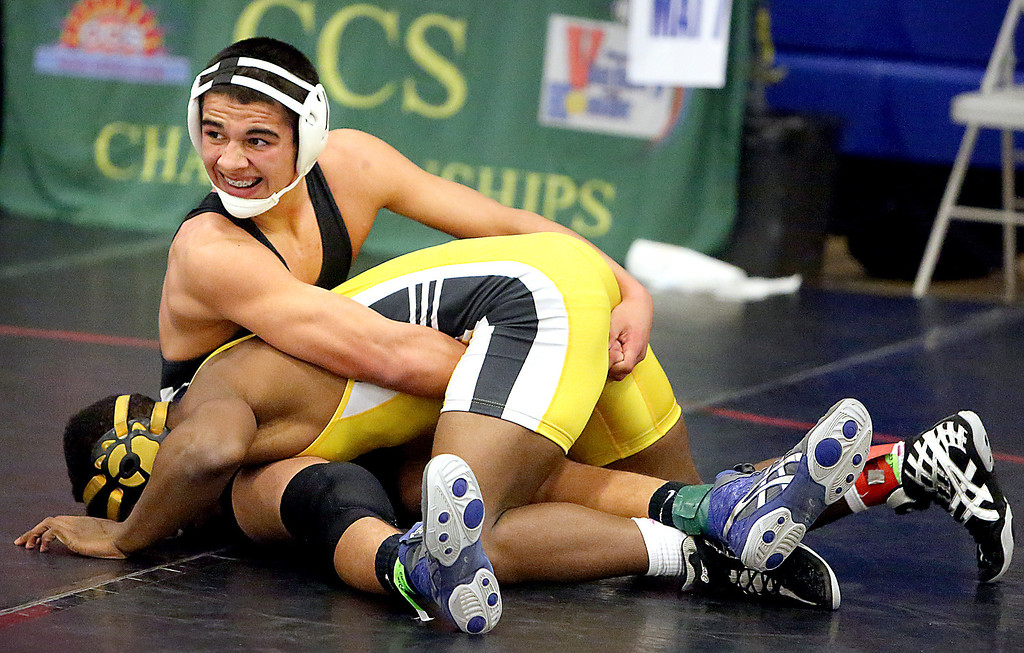 . Aptos High\'s Allen Bjur plows his opponent face first into the mat during the Central Coast Section Wrestling Tournament at Independence High in San Jose, Calif., on Friday, Feb. 22, 2013. (Kevin Johnson/Sentinel)