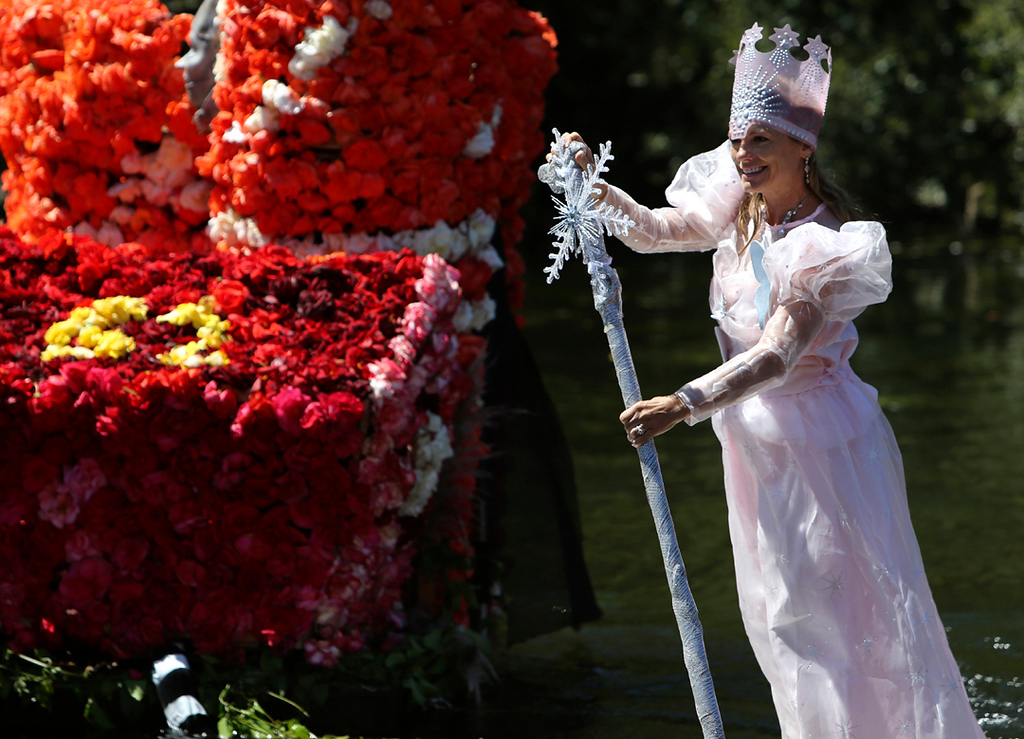 . parade participants draw cheers from the crowds along Soquel Creek in Capitola on Sunday during the annual Begonia Festival. (Kevin Johnson -- Santa Cruz Sentinel)