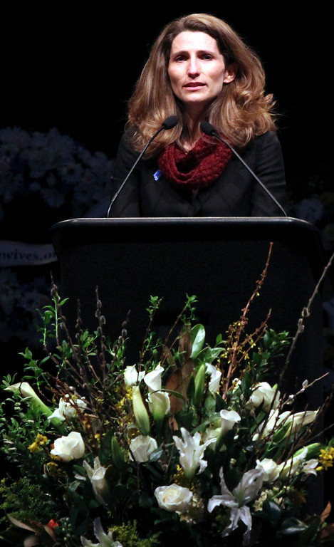 . Alexis Butler speaks lovingly of a recent weekend spent with her sister, Santa Cruz police detective Elizabeth Butler, at the fallen officer\'s memorial service Thursday. (Shmuel Thaler/Sentinel)