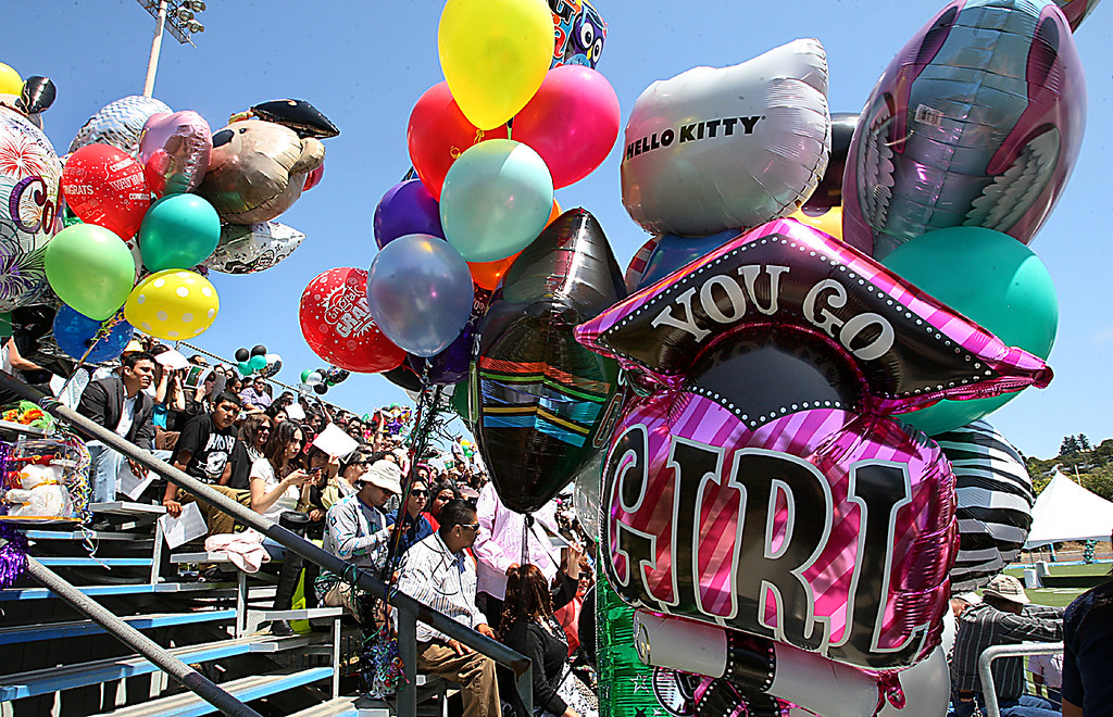 . Balloon bouquets filled the sky at Cabrillo college for Pajaro Valley High\'s graduation ceremony Thursday.  (Dan Coyro/Sentinel)