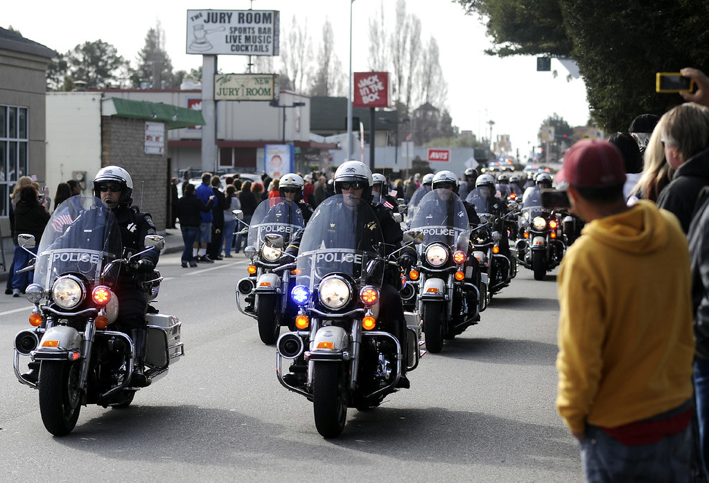 . The funeral procession for detectives Sgt. Loran \'Butch\' Baker and Elizabeth Butler is lead down Ocean Street on Thursday morning by a train of motorcycles headed to HP Pavilion in San Jose, Calif., for memorial services. (Matthew Hintz/Sentinel).