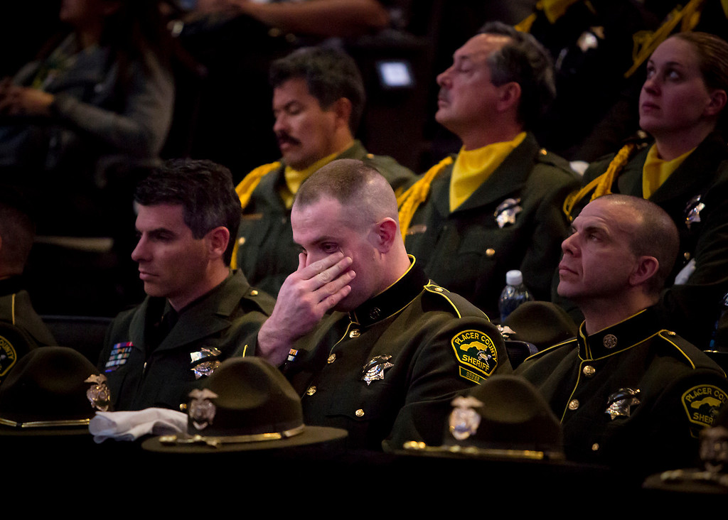 . Tears rolled and the sound of sniffles filled the HP Pavilion in San Jose on Thursday morning as thousands of supporters gathered for the memorial service for Santa Cruz Police detective Sgt. Loran \'Butch\' Baker and detective Elizabeth Butler. (Kevin Johnson/Sentinel)