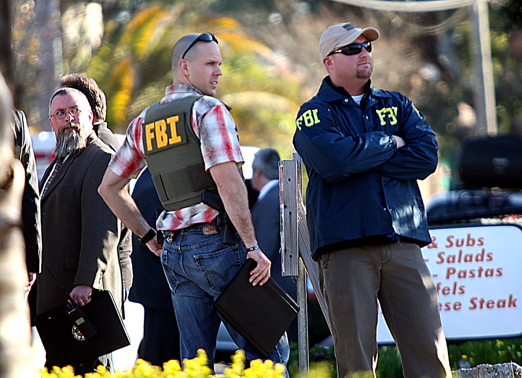 . FBI agents join law enforcement from several agencies at the shooting scene command center near N. Branciforte Avenue and Water Street Tuesday.  (Dan Coyro/Sentinel)